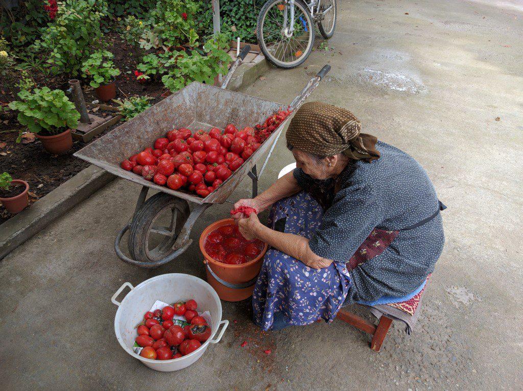 Constantin's grandma preparing tomatos