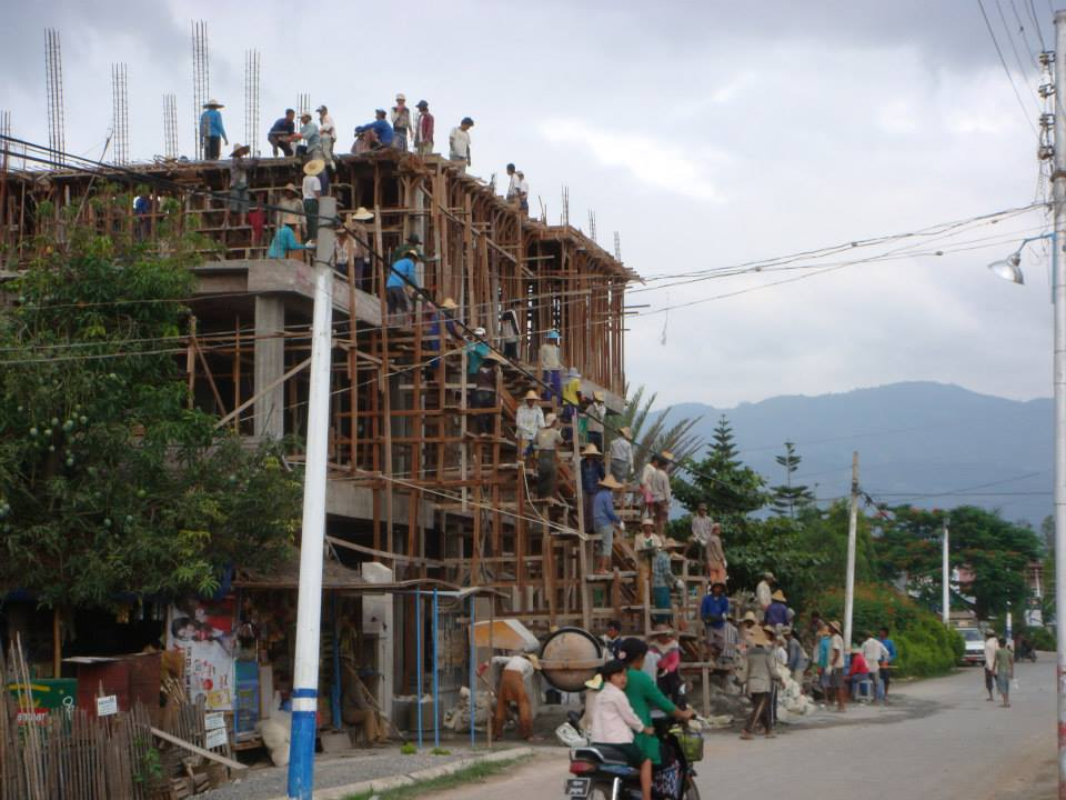 Moving concrete to the top of a structure, by the pan full.