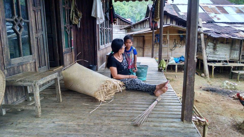 A woman making a basket with her daughter in the second village we stayed in