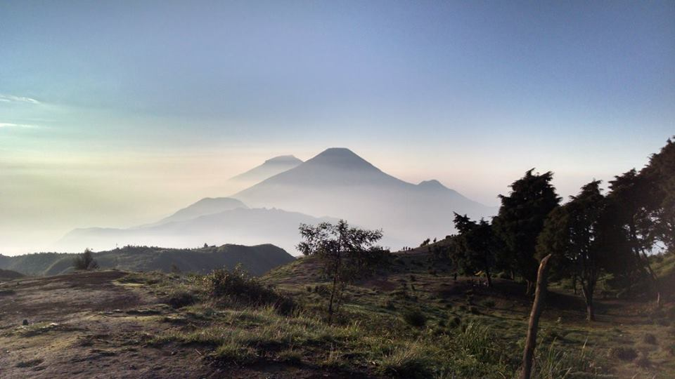 On top of Mt. Prau after sunrise overlooking Mt Sindoro, which we climbed the following night.