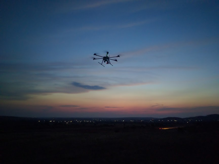 Flying drones at sunset